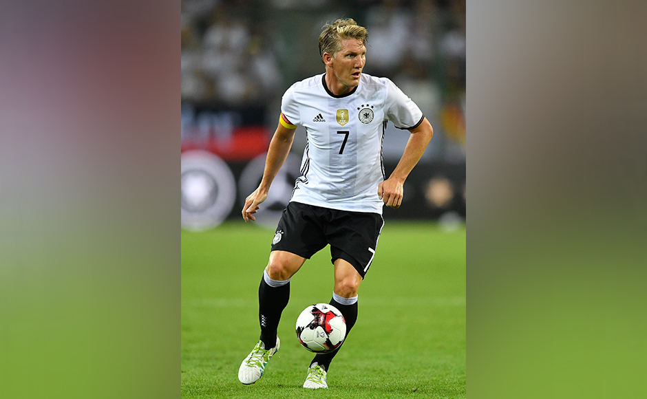 Germany's Bastian Schweinsteiger runs with the ball during a friendly soccer match between Germany and Finland in Moenchengladbach, Germany, Wednesday, Aug. 31, 2016.AP