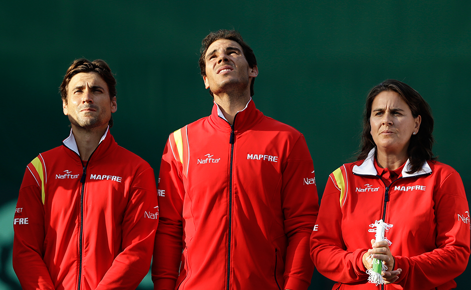 Spanish tennis players, from left, David Ferrer, Rafael Nadal and Conchita Martinez watch balloons being released at the opening ceremony for the tennis Davis Cup play-off round between India and Spain in New Delhi, India, Friday, Sept. 16, 2016. Nadal pulled out of the opening match due to a bad stomach, according to news reports. (AP Photo/Saurabh Das)