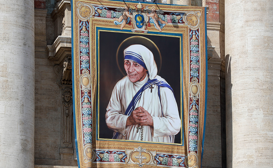 A tapestry showing Mother Teresa hangs from the central balcony of St. Peter's Basilica, in St. Peter's Square, at the Vatican. AP