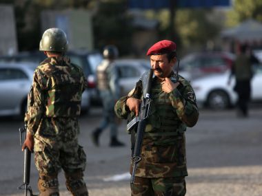 Afghan soldiers inspects the site of suicide attack In Kabul. AP
