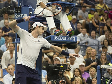 Andy Murray smashes his racket in frustration during a US Open match against Kei Nishikori. AFP