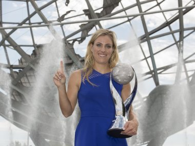Angelique Kerber poses with the WTA World No.1 Trophy. Reuters