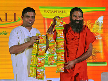 Baba Ramdev (right) with Acharya Balkrishna, CEO, Patanjali