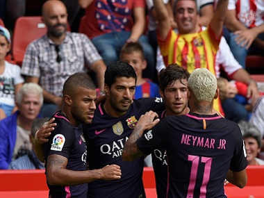 Barcelona players celebrate a goal against Sporting Gijon. Reuters
