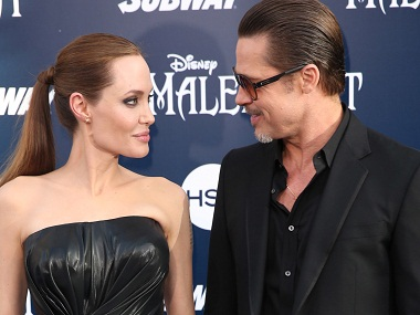 """FILE - In this May 28, 2014 file photo, Angelina Jolie and Brad Pitt arrive at the world premiere of """"Maleficent"""" in Los Angeles. Angelina Jolie Pitt has filed for divorce from Brad Pitt, bringing an end to one of the world's most star-studded, tabloid-generating romances. An attorney for Jolie Pitt, Robert Offer, said Tuesday, Sept. 20, 2016, that she has filed for the dissolution of the marriage. (Photo by Matt Sayles/Invision/AP, File)"""