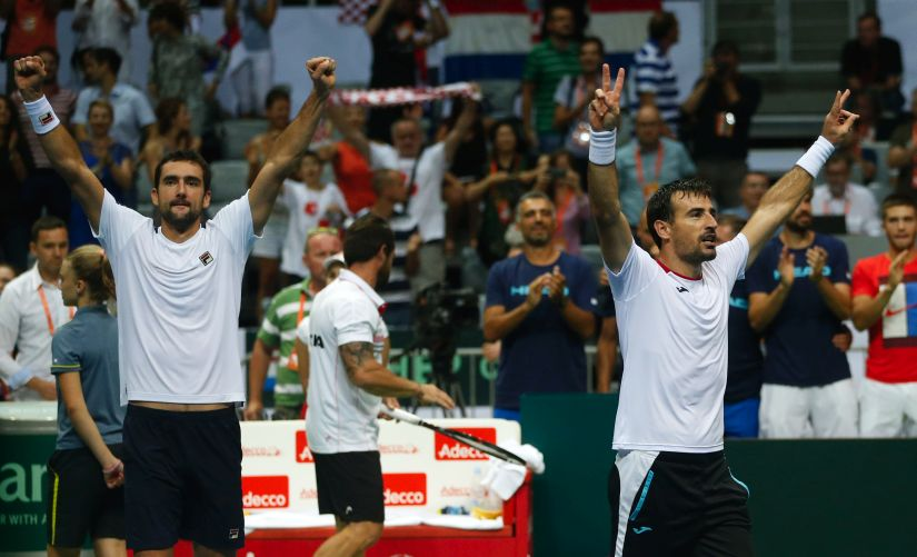 Croatia's Marin Cilic and Ivan Dodig celebrate after winning the doubles match against France. AP