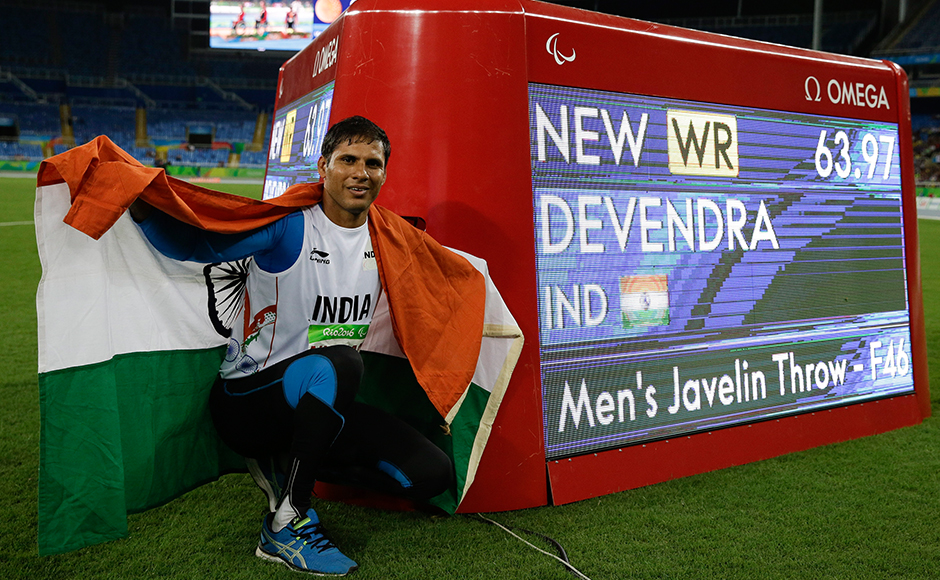 India's Devendra Jhajharia poses for the pictures next to the scoreboard that shows his world record in the men's javelin throw F46 athletics event at the Paralympic Games in Rio de Janeiro, Brazil, Tuesday, Sept. 13, 2016. AP Photo