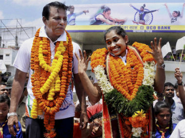 File photo of Dipa Karmakar and her coach in Tripura. PTI