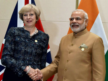 PM Modi with UK PM Theresa May. PTI