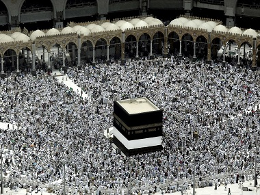Muslim pilgrims prepare themselves for Friday prayers in front of the Kaaba, Islam's holiest shrine, at the Grand Mosque in the Muslim holy city of Mecca, Saudi Arabia, Friday, Sept. 9, 2016. Muslim pilgrims have begun arriving at the holiest sites in Islam ahead of the annual hajj pilgrimage in Saudi Arabia. (AP Photo/Nariman El-Mofty)