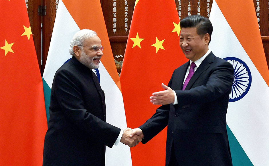 Hangzhou-Prime-Minister-Narendra-Modi-and-Chinese-President-Xi-Jinping-pose-for-photographers-as-they-shake-hands-before-a-bilateral-meeting-at-Westlake-State-House-in-Hangzhou,-China-on-Sunday.-PTI-2
