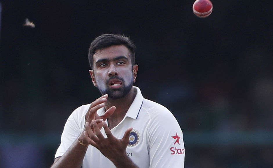 India's Ravichandran Ashwin fields on the fourth day of their first cricket test match against New Zealand at Green Park Stadium in Kanpur, India, Sunday, Sept. 25, 2016. (AP Photo/ Tsering Topgyal)