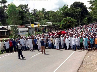 Villagers take part in the funeral procession of the two people who were killed during the clashes with police, in Kaziranga on Tuesday. PTI