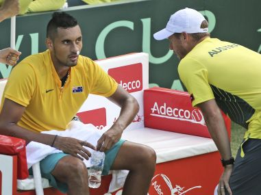Nick Kyrgios in talks with Lleyton Hewitt during his singles Davis Cup match. AP