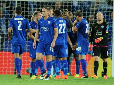 Leicester City players celebrate their victory over FC Porto. AP