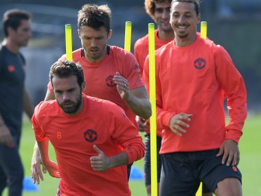 Manchester United players training ahead of their Feyenoord clash. AFP