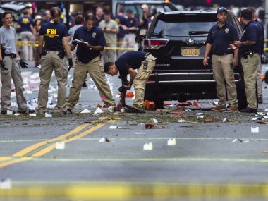 File photo, members of the FBI carry on investigations at the scene of explosion in Manhattan's Chelsea neighborhood. AP