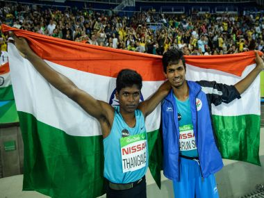 India's Mariyappan Thangavelu and Bhati Varun Singh celebrate their gold and bronze medals. AFP