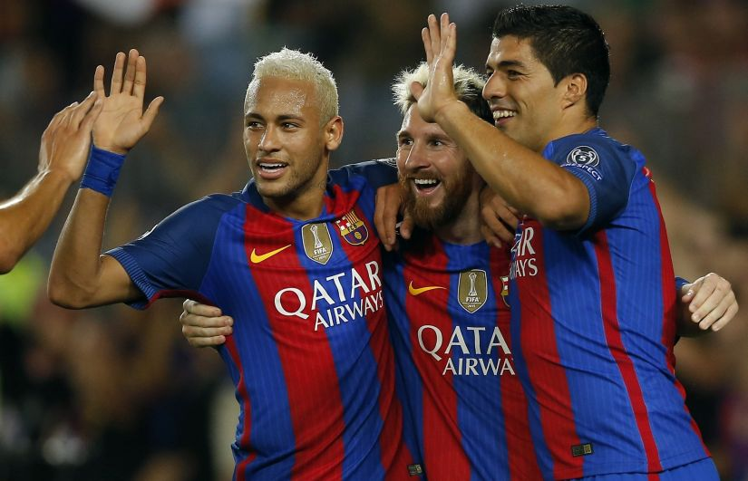 Lionel Messi celebrates with his teammates Luis Suarez, and Neymar. AP