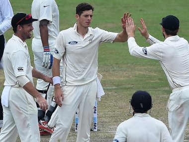 New Zealand's Mitchell Santner celebrates with his teammates on Day 1 of the Test against India. AFP