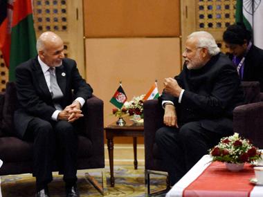 File image of Narendra Modi and Ashraf Ghani. PTI