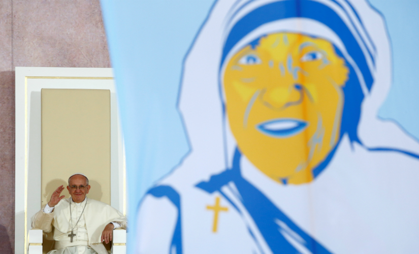 Pope Francis waves at a picture of Mother Teresa during World Youth Days in Poland.  (File image: Reuters)