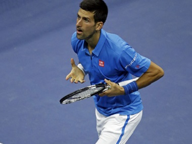 Novak Djokovic gestures to the crowd after defeating Kyle Edmund. AP