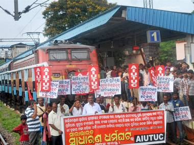 Left party members protesting at railway station while blocking a train during All India Strike in Bhubaneswar. PTI