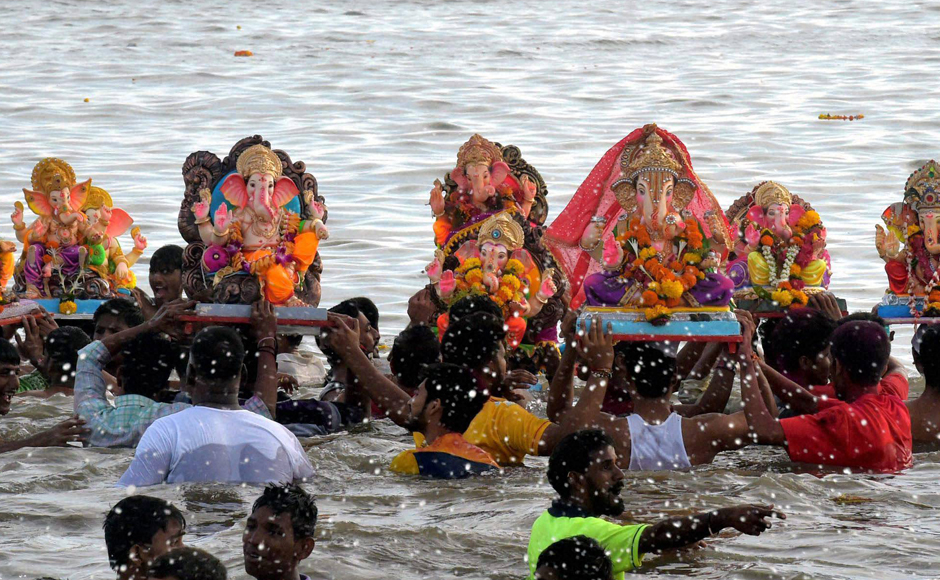 Lord Ganesha, the son of Lord Shiva and Parvati, is widely worshipped as the god of wisdom, prosperity and good fortune and traditionally invoked at the beginning of any new venture. Devotees carry Ganesh idols for immersion in the Arabian sea on Saturday. (Photo courtesy: PTI)