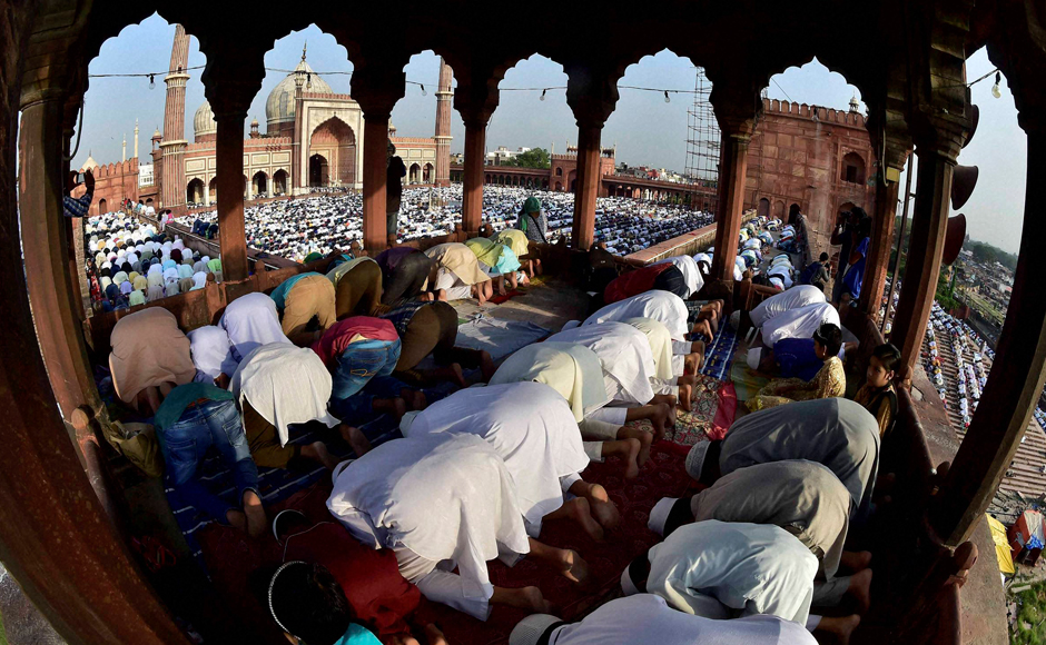 """Muslims offer Eid al-Adha prayers at Jama Masjid in New Delhi on Tuesday. Muslims worldwide are celebrating Eid al-Adha, or """"Feast of Sacrifice,"""" that commemorates the willingness of the Prophet Ibrahim to sacrifice his son before God stayed his hand. During the holiday, Muslims slaughter livestock and distribute part of the meat to the poor. (Photo: PTI)"""
