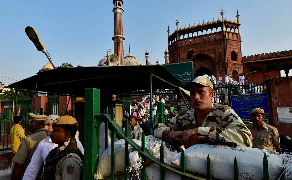 Eid commemorates this extraordinary display of faith in Allah and Muslims celebrate it by sacrificing animals on this day. Securitymen stand guard outside Delhi's Jama Masjid during Eid prayers on Tuesday. (Photo: PTI)