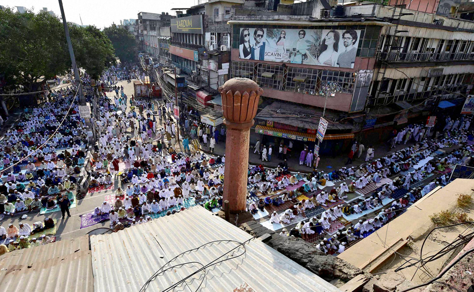 President Pranab Mukherjee on Monday greeted fellow citizens on the eve of Eid and expressed hope that the festival will strengthen the efforts of the people to enhance universal brotherhood, peace and harmony in the society. Muslims offer Eid prayers outside old-Delhi's Fatehpuri Masjid on Tuesday. (Photo: PTI)