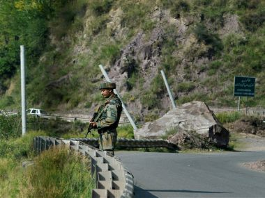 An Army man stand guards near Army Brigade camp during a terror attack in Uri, Jammu and Kashmir on Sunday. PTI