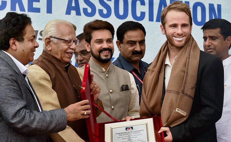 UP Governor Ram Naik and IPL Chairman Rajeev Shukla present a memento to New Zealand captain Kane Williamson, as BCCI President Anurag Thakur looks on, on the occasion of India's 500th Test match at Green Park in Kanpur on Thursday. PTI Photo(PTI9_22_2016_000045B)