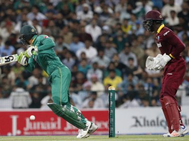File photo of Pakistan and West Indies cricket players in action. AFP