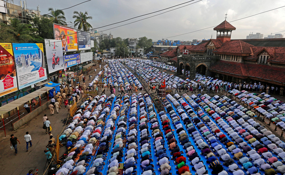 People offer Eid prayers on a street outside a railway station in Mumbai. Additional arrangements were made outside the roads, on pavements and other open areas to accommodate the huge rush. Some places erected special marquees as a precaution against the rains in view of overcast skies. Maharashtra Governor CV Rao and CM Devendra Fadnavis warmly greeted the Muslims on the occasion. (Photo: Reuters)