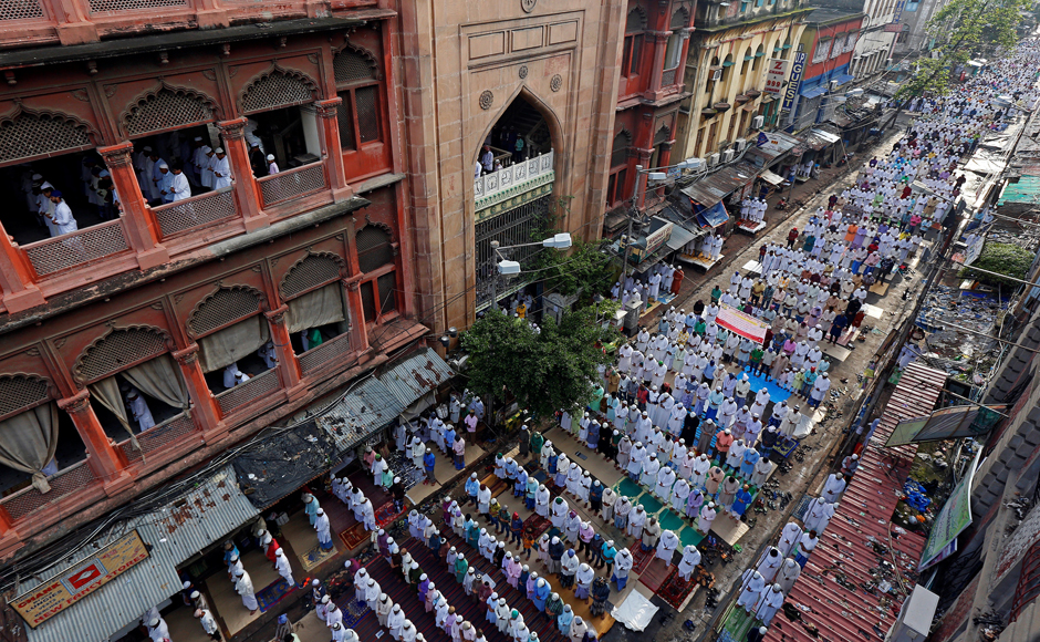 However, for the rest of India, Eid was celebrated with much fanfare. People offer Eid prayers on a street outside a mosque in Kolkata. (Photo: Reuters)