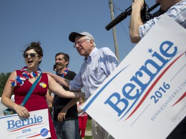 Bernie Sanders takes photos with supporters. Reuters