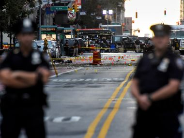 New York City Police Department officers stand near the site of an explosion in the Chelsea neighborhood of Manhattan. Reuters