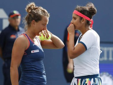 Sania Mirza talks with doubles partner Barbora Strycova at the US Open. AP