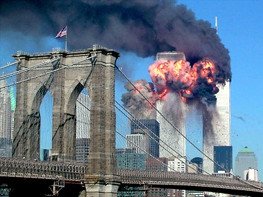The second tower of the World Trade Center bursts into flames after being hit by a hijacked airplane in New York in this September 11, 2001 file photograph. Al Qaeda leader Osama bin Laden was killed in a firefight with U.S. forces in Pakistan on May 1, 2011, ending a nearly 10-year worldwide hunt for the mastermind of the Sept. 11 attacks. The Brooklyn bridge is seen in the foreground. REUTERS/Sara K. Schwittek/Files (UNITED STATES - Tags: POLITICS CIVIL UNREST) - RTR2LVZB