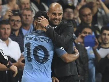 Manchester City's Spanish manager Pep Guardiola with Sergio Aguero. AFP