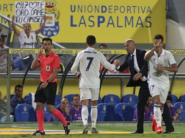 Cristiano Ronaldo shakes hands with Real Madrid's head coach Zinedine Zidane after being substituted. AP