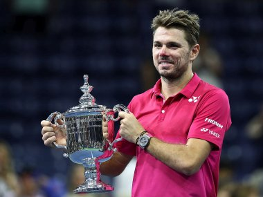 Stan Wawrinka with the trophy after defeating Novak Djokovic in the US Open final. Getty