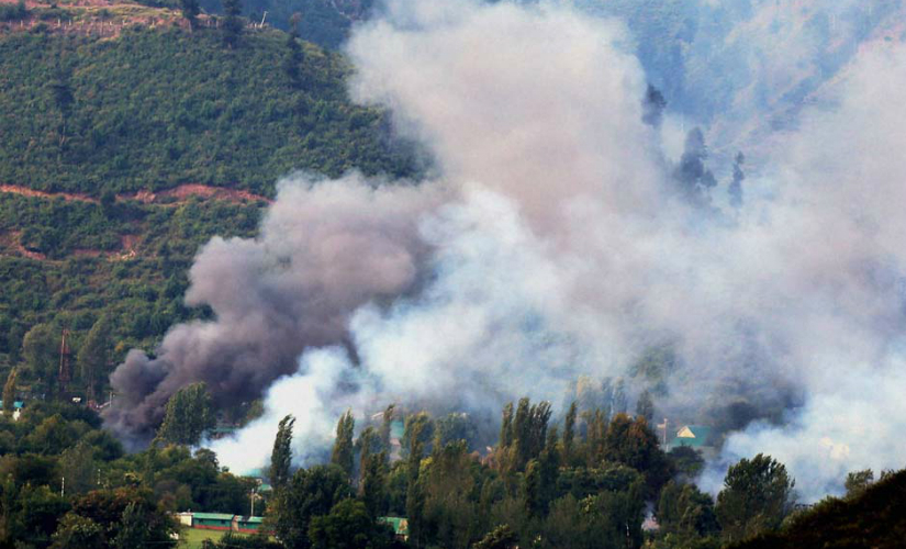 Smoke rises from the Army Brigade camp in Uri. PTI