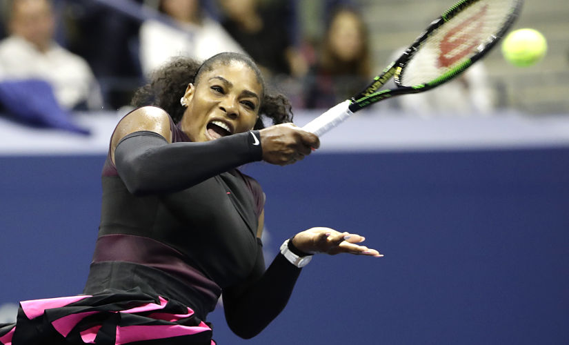 Serena Williams returns the ball against Simona Halep. AP