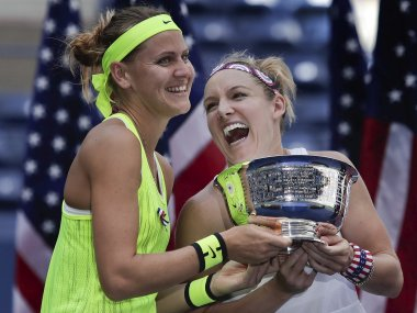 Lucie Safarova and Bethanie Mattek-Sands hold the US Open women's doubles championship trophy. AP