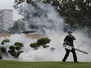 A pest control worker fumigates drains and the gardens at a local housing estate where the latest case of Zika infections were reported from on Thursday, Sept. 1, 2016, in Singapore. Indonesia is screening travelers from neighboring Singapore for the mosquito-borne Zika virus as the city-state reports a growing number of infections and its first case of a pregnant woman testing positive. (AP Photo/Wong Maye-E)