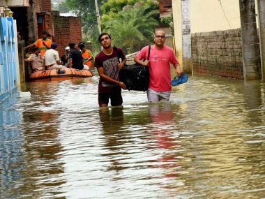 Residents in a flood-hit locality in Gaya. PTI