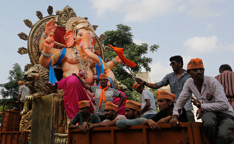 Indians transport an idol of elephant-headed Hindu God Ganesha on a vehicle ahead of Ganesh Chaturthi festival in Ahmadabad, India, Saturday, Sept. 3, 2016. The ten-day long Ganesh festival begins on Sept. 5. (AP Photo/Ajit Solanki)